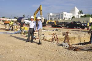 Homestead Mayor Jeff Porter and Vice Mayor Stephen Shelley at the bustling  construction site of Homestead Station, Mowry Drive and Krome Avenue.