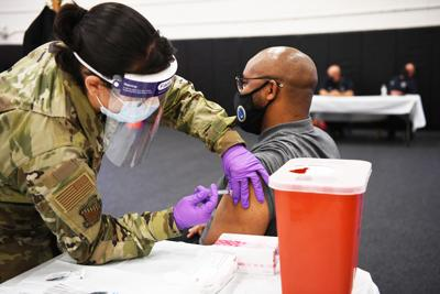 A member of team Homestead  receives the COVID-19 vaccine  at a vaccination event during the  August Unit Training Assembly Aug. 7, 2021 at HARB.