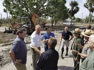 Federal and state officials along with private partners met at Flamingo in Everglades National Park committing to rebuild from damage caused by Hurricane Irma.  Pictured from center left: Secretary of the Dept. of Interior Ryan Zinke (white shirt), Sen. Marco Rubio and Rep. Bryan Mast (cane).