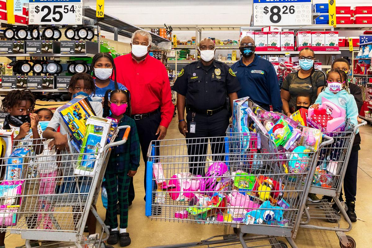 Mayor Otis Wallace, Police Lieutenant James Butts, and Commissioner James Gold, joined families  and kids as they participated in the toy give away.