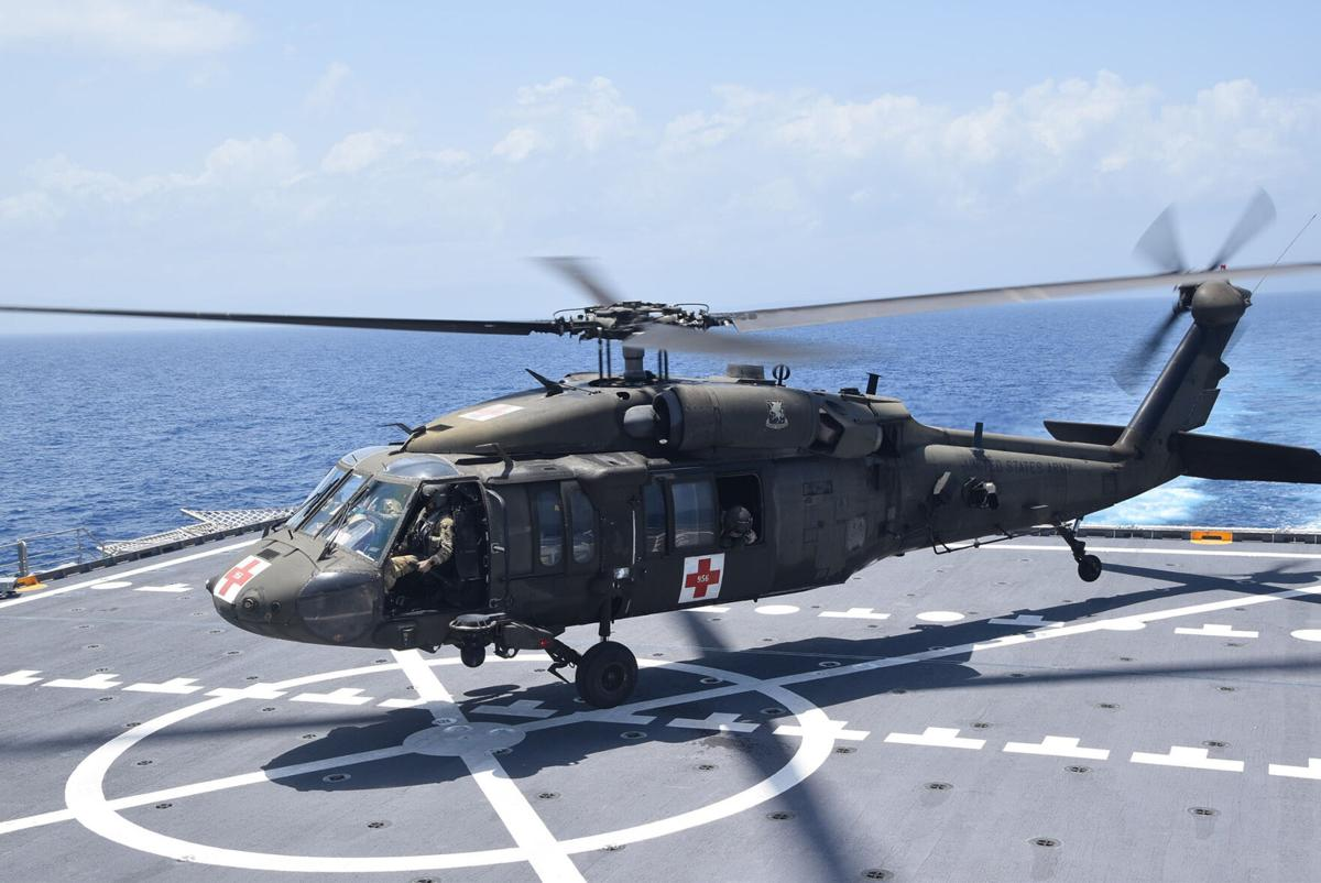 A U.S. Army UH-60 Blackhawk helicopter lands on the fast transport ship USNS Burlington to refuel, Aug. 21, 2021. Burlington is deployed to support humanitarian assistance and disaster relief (HADR) efforts in Haiti. U.S. Navy