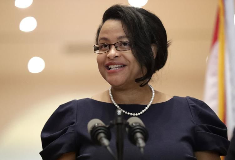 Renatha Francis smiles as she speaks during a news conference Tuesday, May 26, at the Miami-Dade Public Library.