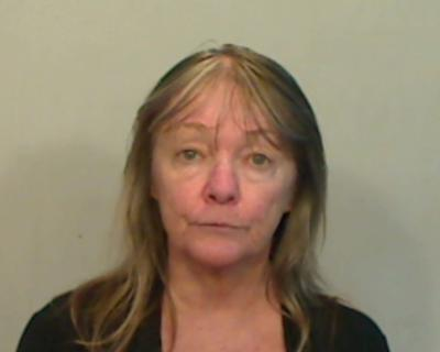Juanita Powell Legate, 62, of  Plantation Key, was charged with 3 counts.