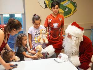 Santa visits with children at Homestead Hospital.