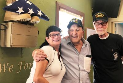 Yolanda Negron and Rusty Balletti, longtime members of Homestead VFW, enjoy hearing Frenchy's stories