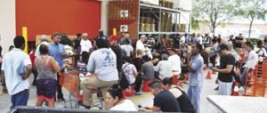 Hundreds waited in lines at Home Depot in Florida City Wednesday afternoon for needed supplies to protect their homes and families. The store was out of plywood and store management told the crowd the next shipment was coming but they could not be sure what time. To ease the situation store employees brought 5-gal. handy-man buckets for everyone to sit on while they waited. Given the possibilities of the most devastating storm to reach our area since Hurricane Andrew 25 years ago, the crowd for the most part was in high spirits. One woman said with tongue at least partially in cheek,