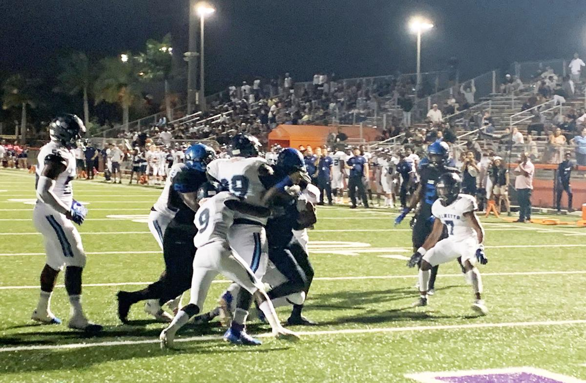 South Dade's Kelvin Durham rushes into the end zone.