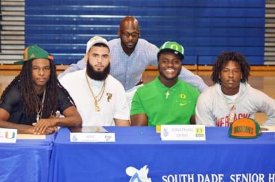 Coach Nate Hudson with Keshawn Washington,  Jose Mirabal, Jonathan Denis, and Jaiden Francois  (from left to right)