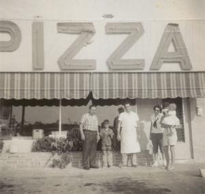 This 1958 photo shows Richard Accursio in the apron, his wife Frances Marlyn to his right and the other individuals are the Joe Traina family, first cousins.