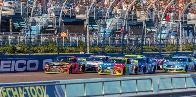 The series leaders bunch up during a caution, at Sunday's championship race.