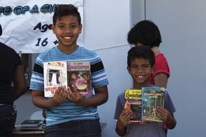 The classic Hardy Boys and more current Goose Bumps bring smiles to young faces