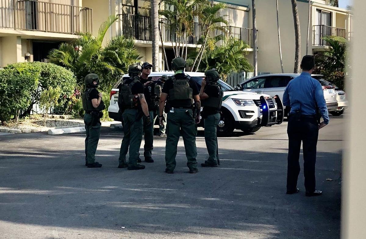 Police search for stabbing suspect in parking lot of Executive Bay Condos, Islamorada.