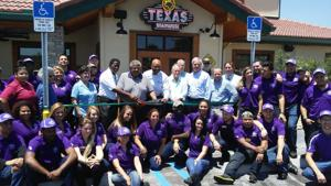Pictured are Florida City Mayor Otis Wallace, Homestead Mayor Jeff Porter, Managing Partner of Texas Roadhouse Lisa Iannaconi, along with community leaders, Chamber of Commerce members, and many happy new Texas Roadhouse employees.