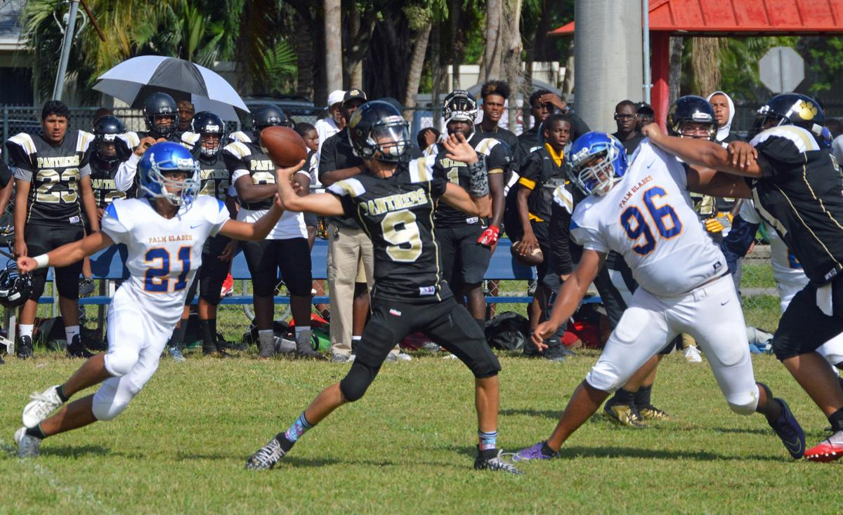 Everglades Prep's Angel Mercado throwing a pass with William Carrion (21) and Shelton Navarro (96) converging