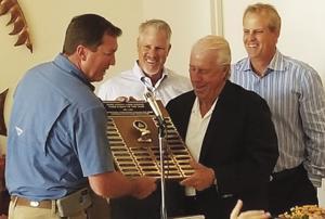 Dade County Farm Bureau President Erik Tietig honors the Dimare Family, (from left) Tony Dimare,  Paul Dimare and Scott Dimare.
