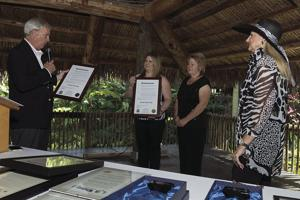Homestead Mayor Jeff Porter reads a proclamation honoring Jessica Borek and Pamela Vick, supported by Carol Harris, chair, Dade County Farm Bureau Women's Committee