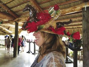 "Patti Marraccini won the ""Most Original Hat"" award in her elegant, personally designed hat ."