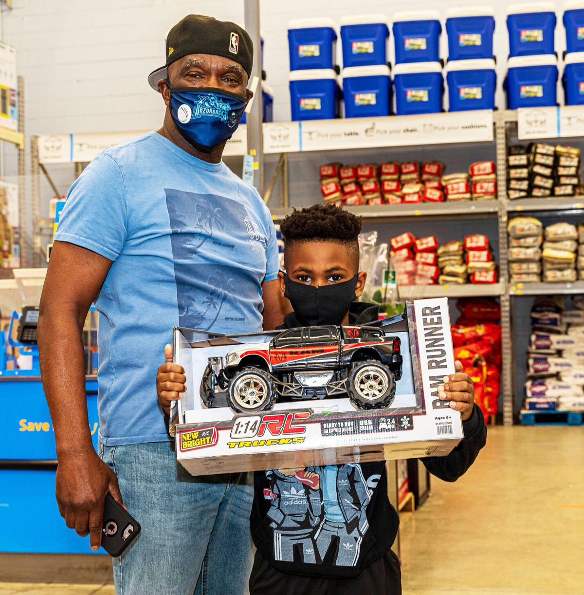 Happy young man with his new RC truck, one of the toys he picked as part of the toy give away