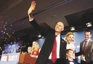 Gov. Rick Scott celebrates with his family as he wins a US Senate seat.