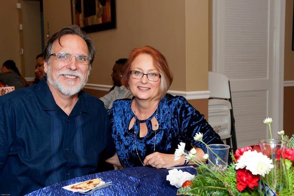 Pastor Rick Lee with is wife Debbie at a Christmas party.