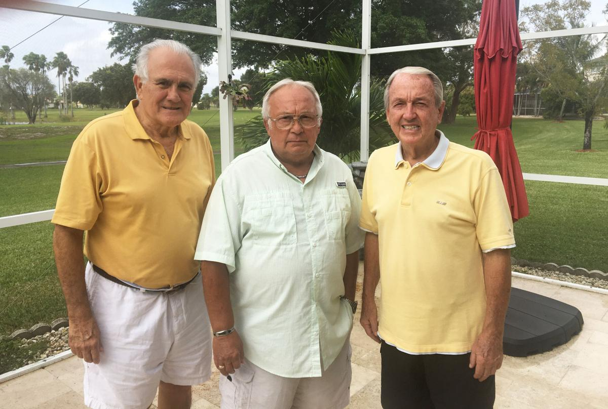 From left:  Julio Lago, Dennis Rice and Morris Henry with the Keys Gate golf course behind them.