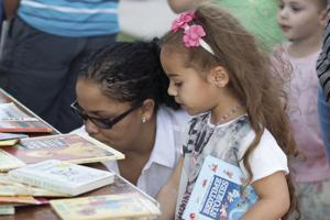 Children and Adults enjoy looking through the book selection