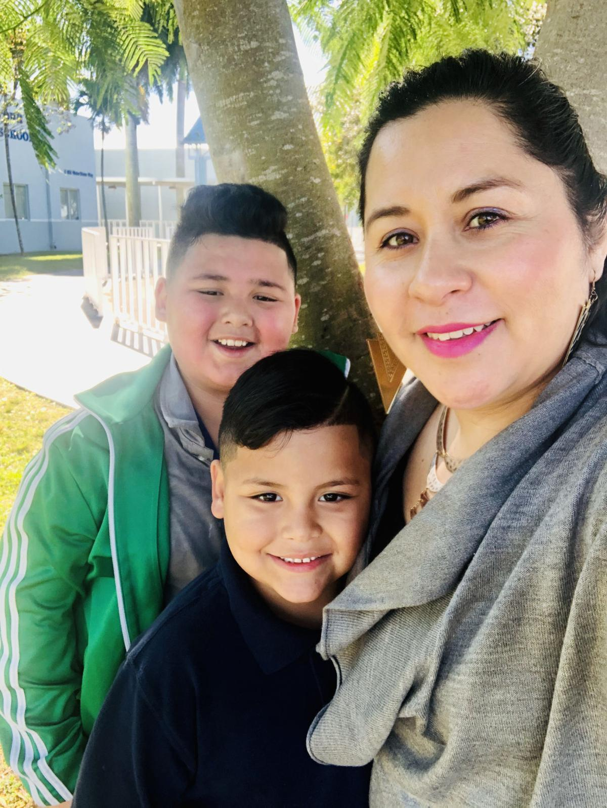 Vicky Saldivar with grandsons Moises and Anthony.
