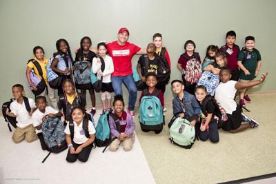 New, full backpacks brought smiles to the students of Coconut Palm K-8 Academy.   Pictured with Alex Price, National Director of Community Investment with Office Depot.