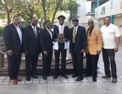 From left: , Gilbert Estime, Takevess Hatcher, Leslie Elus, Donovan Ferguson (scholarship recipient), Glynell Bradley, Edward Woodbury, and Assistant Principal Anthony Burns