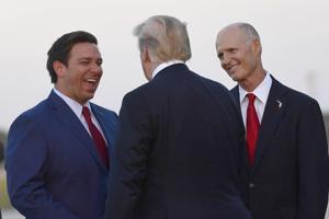 Gov. Ron DeSantis and Sen. Rick Scott at a 2018 appearance with President Trump.