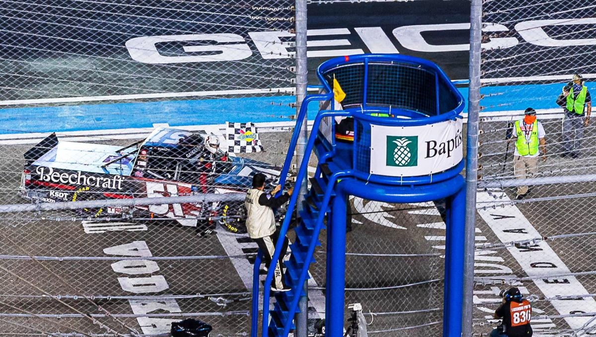 Kyle Busch takes the checkered flage on Saturday at Homestead.