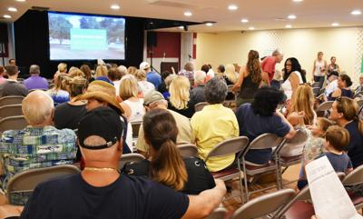 It was standing room only at the Lions Club in Key Largo to protest a housing project to be built on the perimeter of Key Largo park in Port Largo.