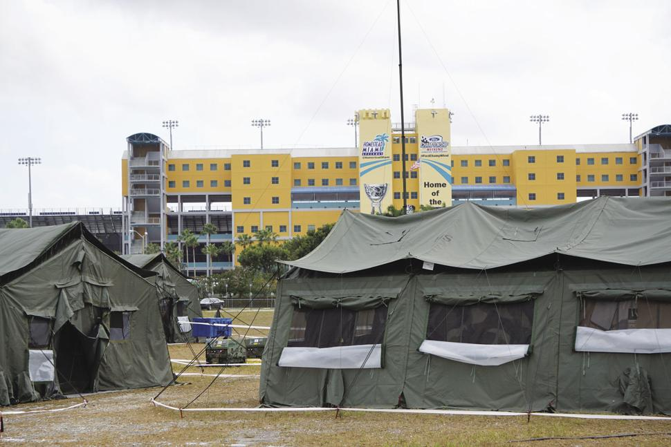 US Army Reserve training tents frame the foreground at Homestead-Miami Speedway.