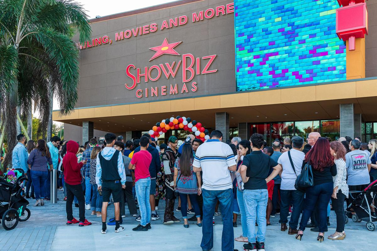 The lively crowd for the ribbon cutting was eager to see  inside the ShowBiz complex.