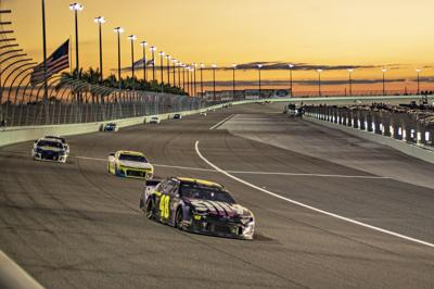 Championship racing at twilight during the Ford EcoBoost 400, last November, at Homestead-Miami Speedway.