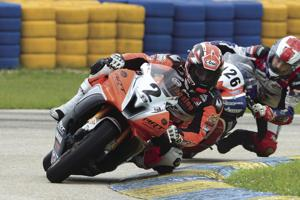 #2 Lucas Silva leading #126 Max Angles through turn 3 at Homestead-Miami Speedway on June 4th.