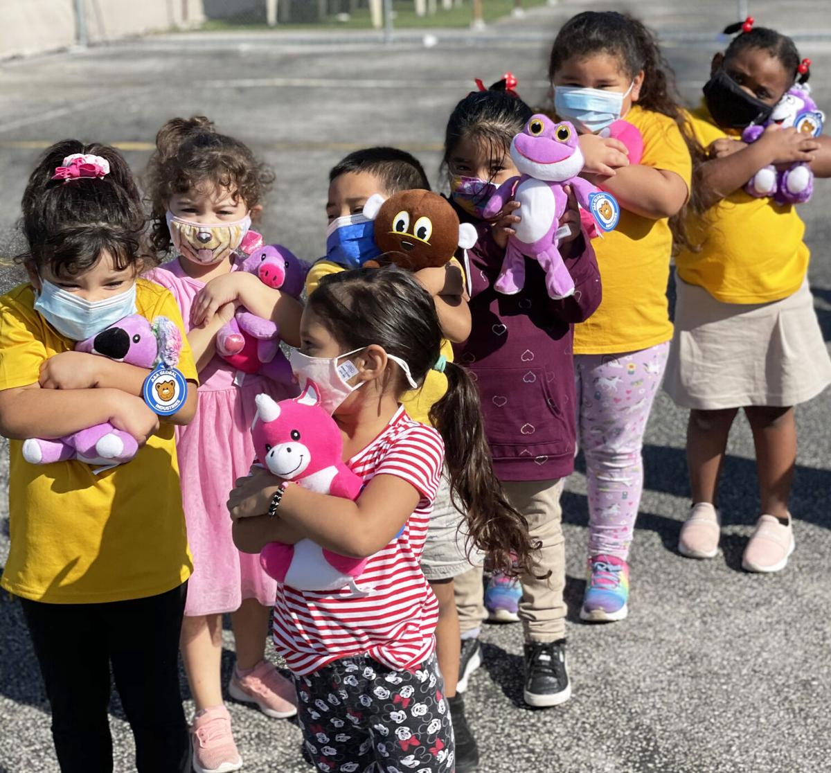 Kids at ARC Project #5 enjoy their Christmas gifts from the Kiwanis Club of Homestead-South Dade.  The club made several visits to daycare facilities throughout the area—despite the COVID-19 pandemic—as part of its nearly 20-year tradition.