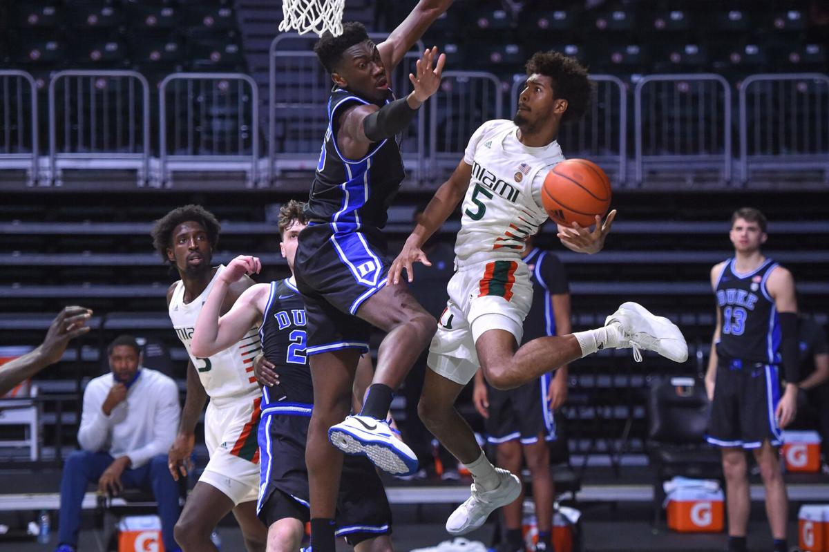 """Miami's Harlond Beverly, 6'5"""" sophomore guard goes up for the shot."""