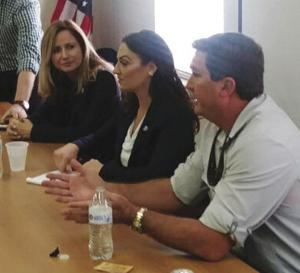 Meeting with area farmers at the Dade County Farm Bureau offices were (from left) Rep. Debbie Mucarsel-Powell, Ag Comm. Nikki Fried, and Farm Bureau President Eric Tietig.