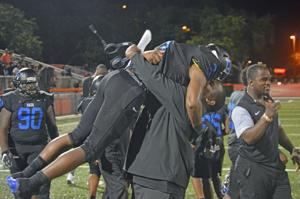 Demetrius Randolph celebrates with offensive coordinator Herman Reaves
