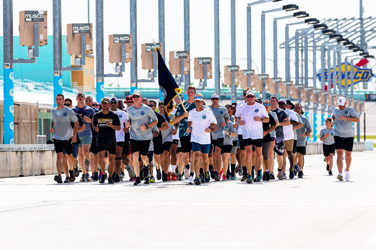 A formation of SOCSOUTH personnel led by their Commander Rear Admiral Keith Davids complete the last lap of the Run.
