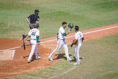 Yohandy Morales highfives Anthony Vilar.