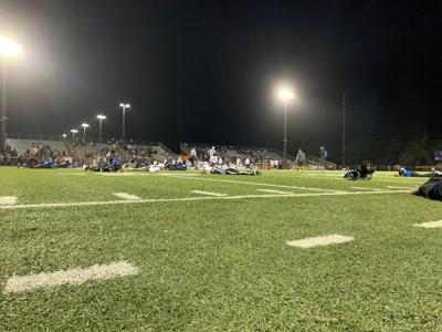 Players, coaches, officials and press lay flat on the field, as play was stopped in the fourth quarter after a fight in the stands caused a scare of a shooting.
