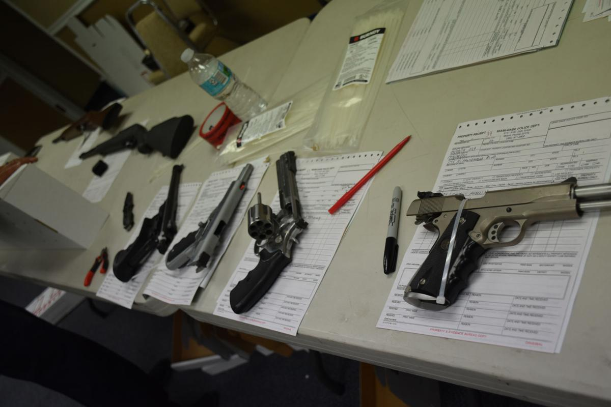 A few of the guns being processed for turn in