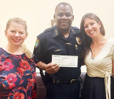 Photo, from left: Assistant Branch Manager Monika Kuhn, Florida City Chief of Police Pedro Taylor, and Branch Manager Stephanie Jacobowitz.