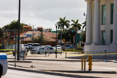 Miami-Dade PD personnel continued to work the crime scene around  Homestead City Hall.