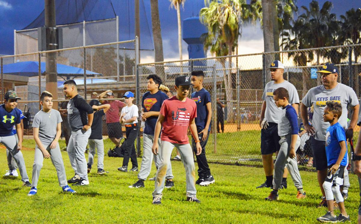 Keys Gate head coach Rich Benavides (far right) along with his fellow coaches and players lead free pre-season clinic.