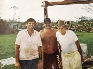 On our missing back porch with destroyed grove and fish farm in background. From left:  Phill Marraccini, Donnie Walthers (fish farmer from Kissimmee) and Phil Marraccini Sr.