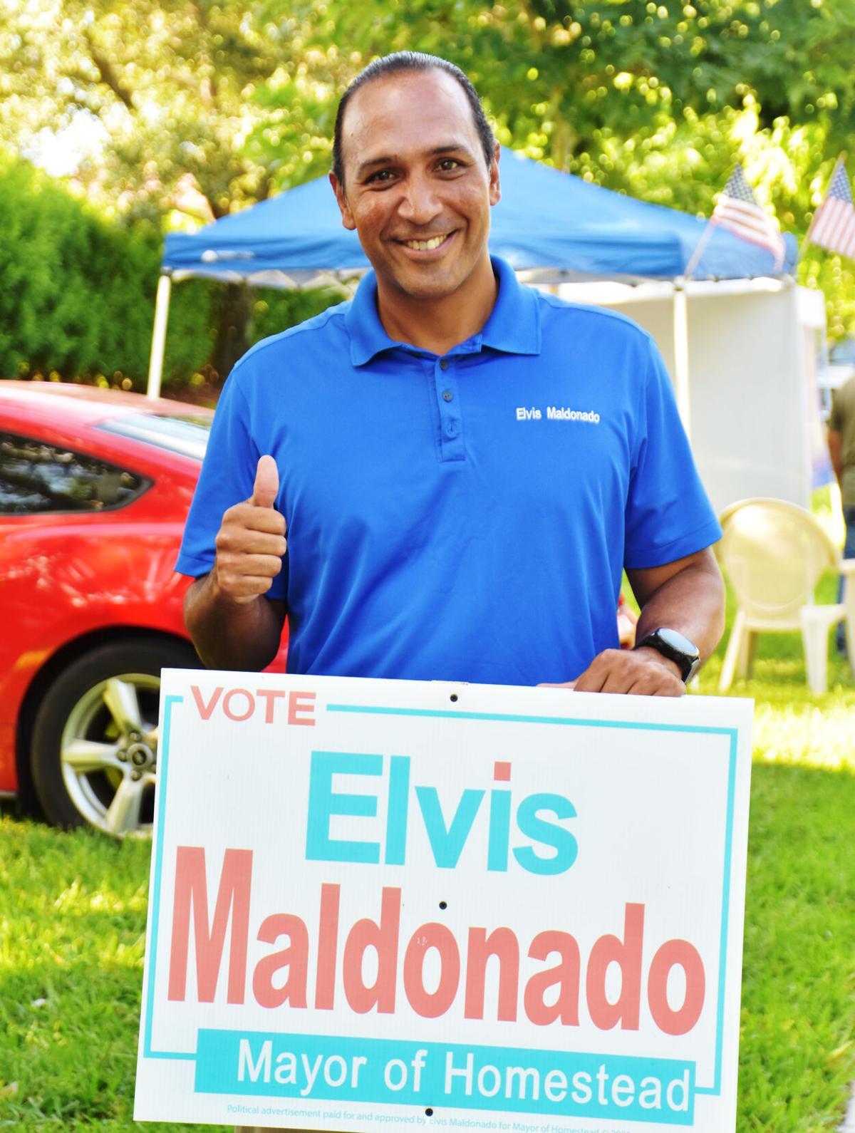 Elvis Maldonado (right) at the polls on Tuesday.