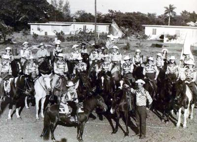 Members of the 1950s Everglades Posse always draw  applause whether during parades or their appearance in the arena.